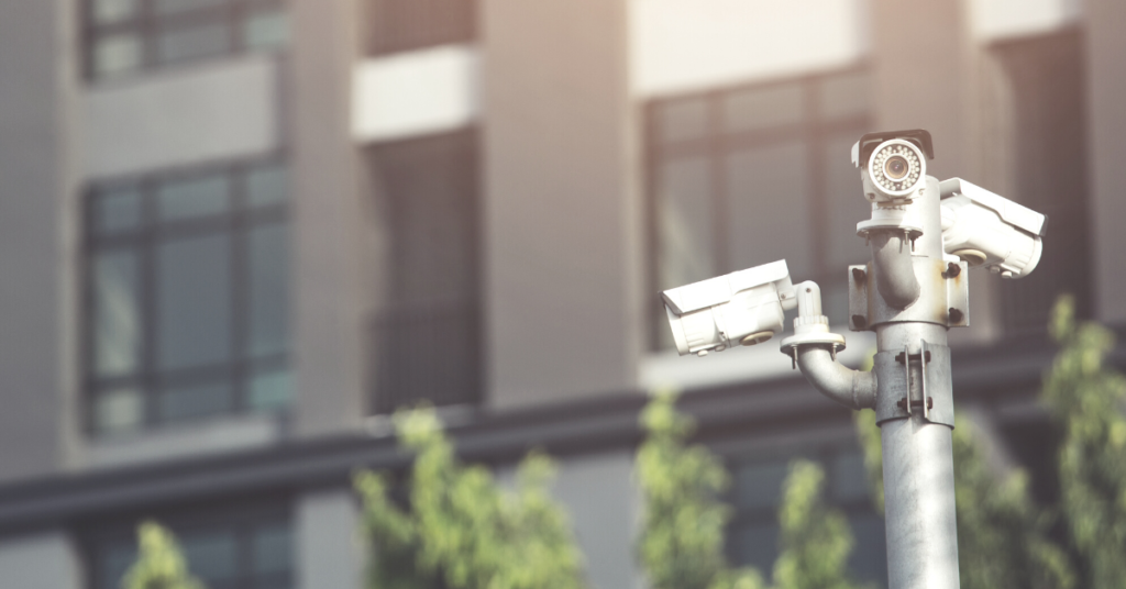 municipal property surveillance equipment on a pole near apartment building