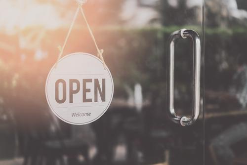 open sign hanging on door