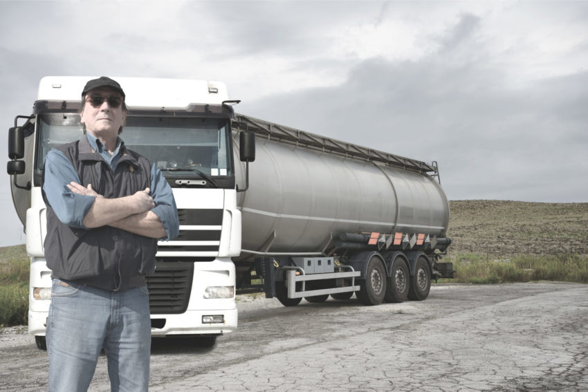 man standing in front of his leased truck